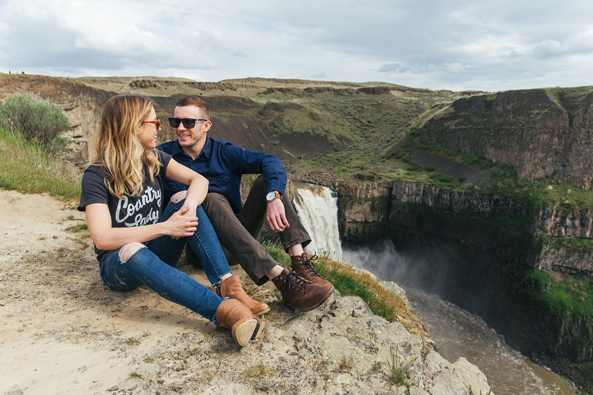 Couple sitting down at Palouse Falls