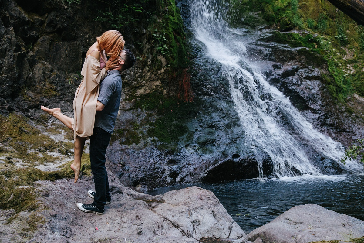 Couple dancing next to waterfall