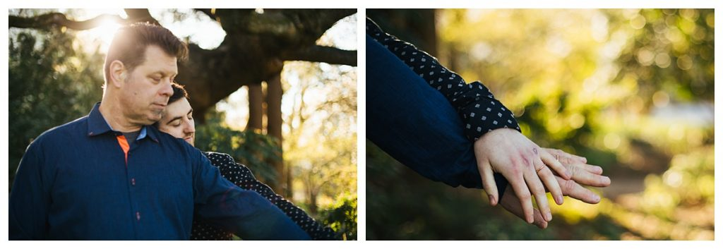 Golden Gardens Engagement session, couple at nearby park underneath cherry blossoms close up of their hands with wedding bands on them