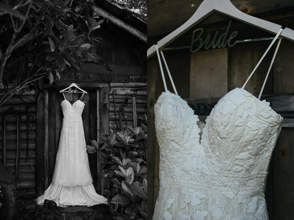 beau lodge wedding brides dress hanging on wooden shed