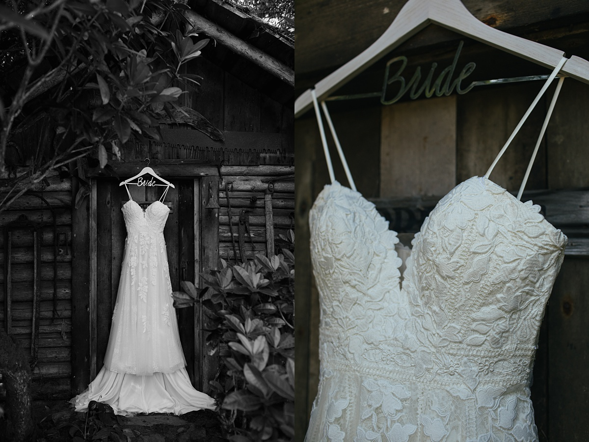 beau lodge wedding brides dress hanging on wooden shed