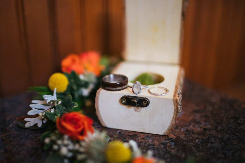 beau lodge wedding details of bride and grooms wedding rings