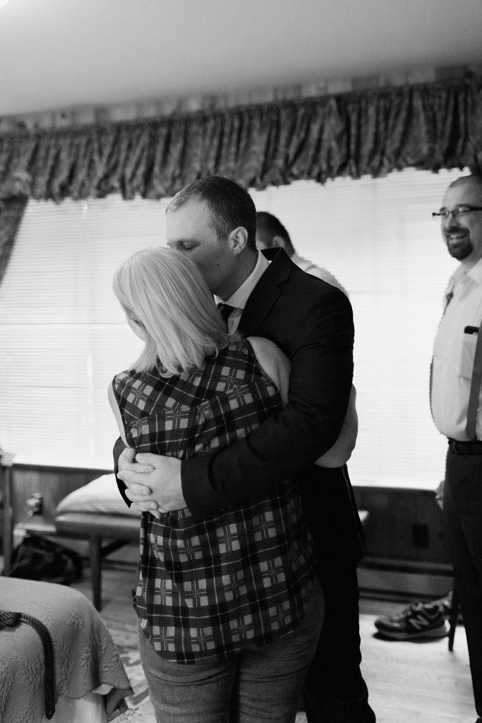 beau lodge wedding groom kissing mom before wedding