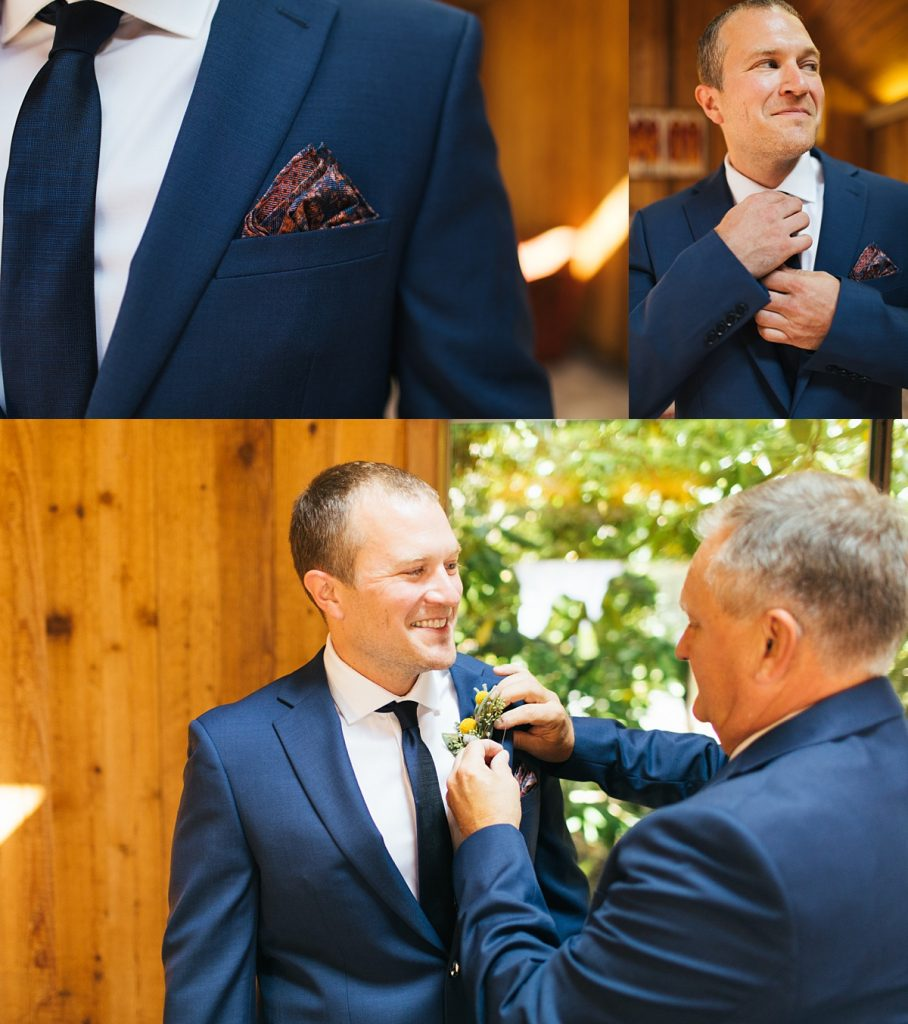 beau lodge wedding groom getting ready, dad putting on boutonnière to groom