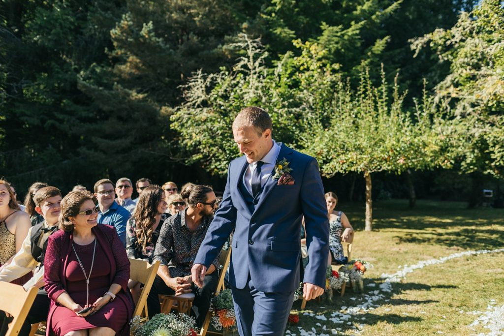 beau lodge wedding groom walking down aisle