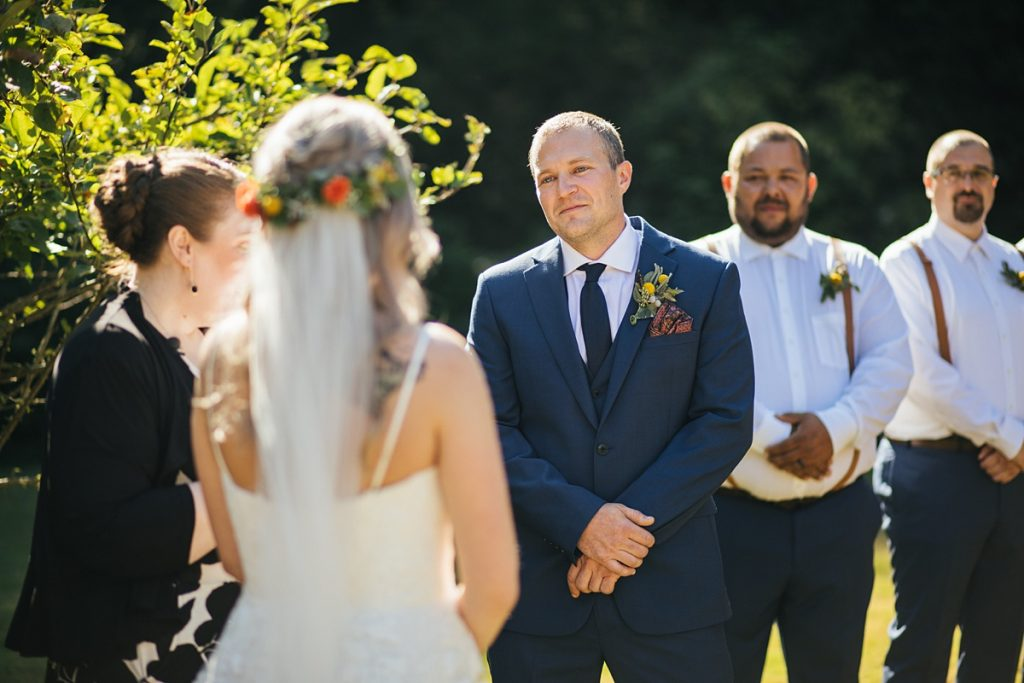 beau lodge wedding groom smiling at bride during wedding ceremony