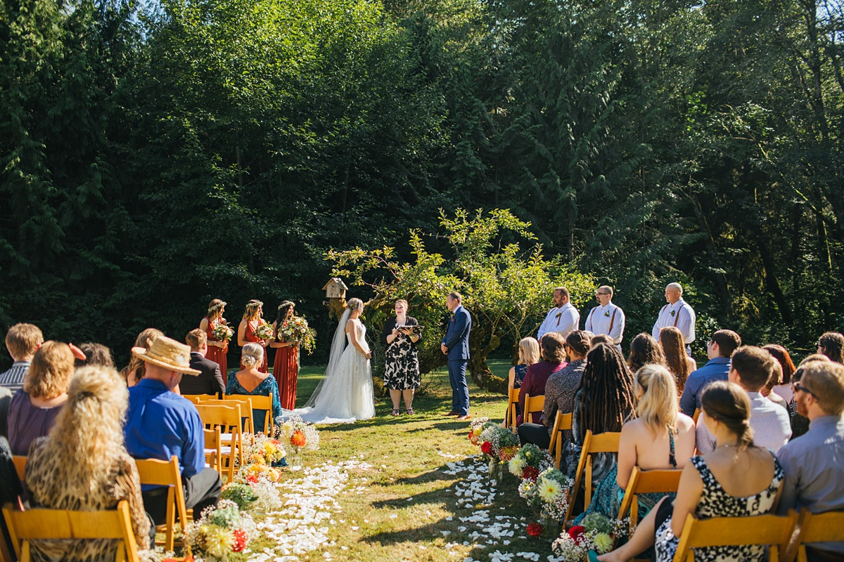 beau lodge wedding bride and groom wedding ceremony next to a tree in a field