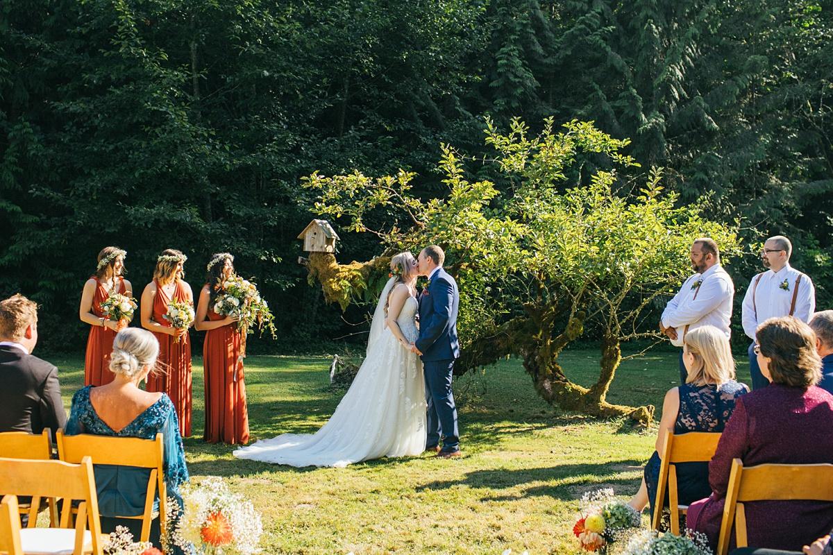 beau lodge wedding bride and groom first kiss