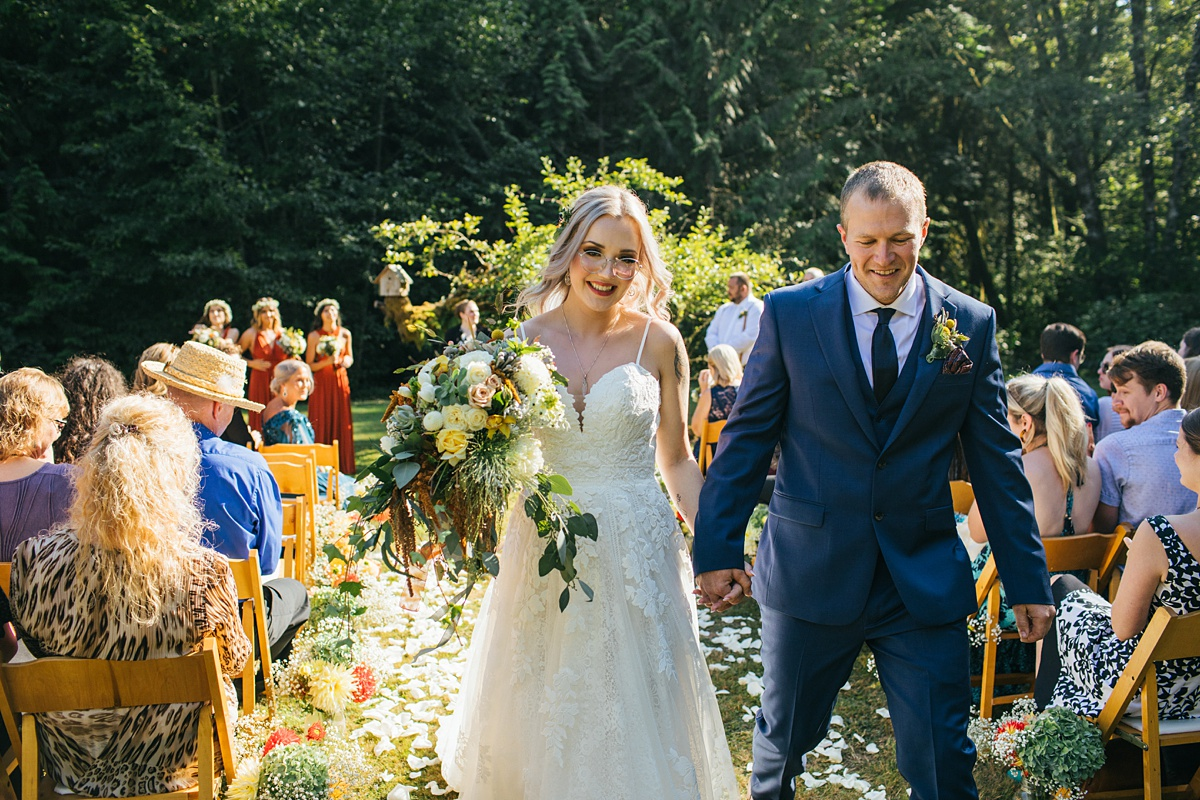 beau lodge wedding bride and groom walking back down aisle