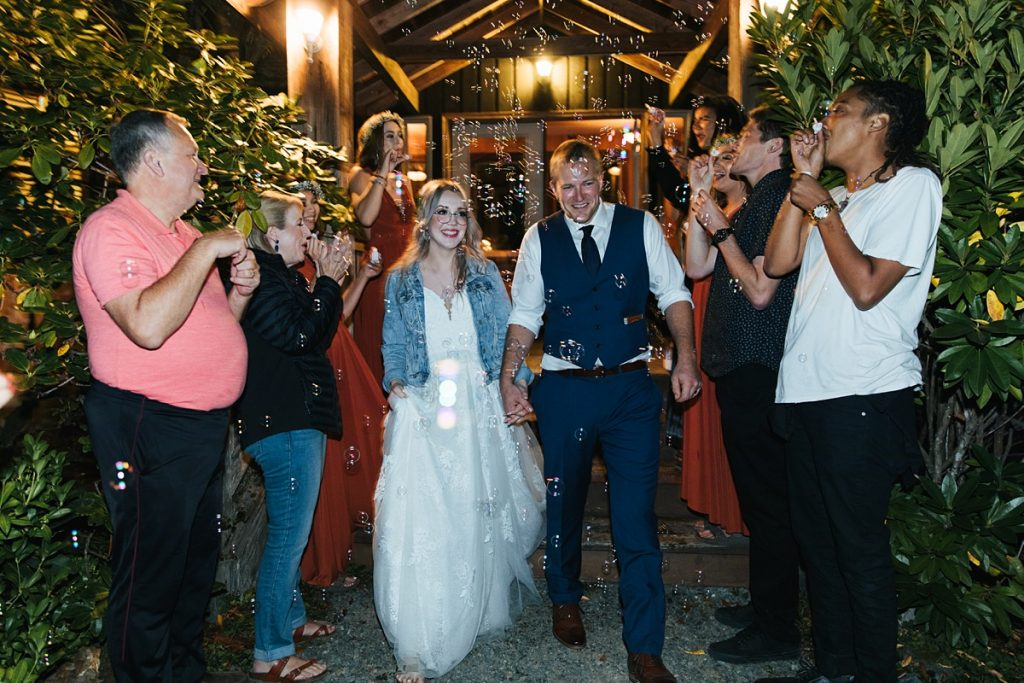 beau lodge wedding bride and groom exit with bubbles
