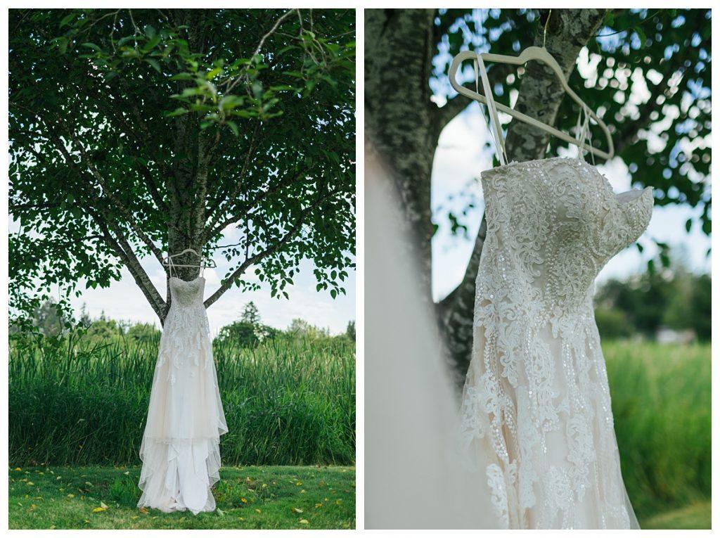 Bostic Lake Ranch Wedding wedding dress hanging on tree