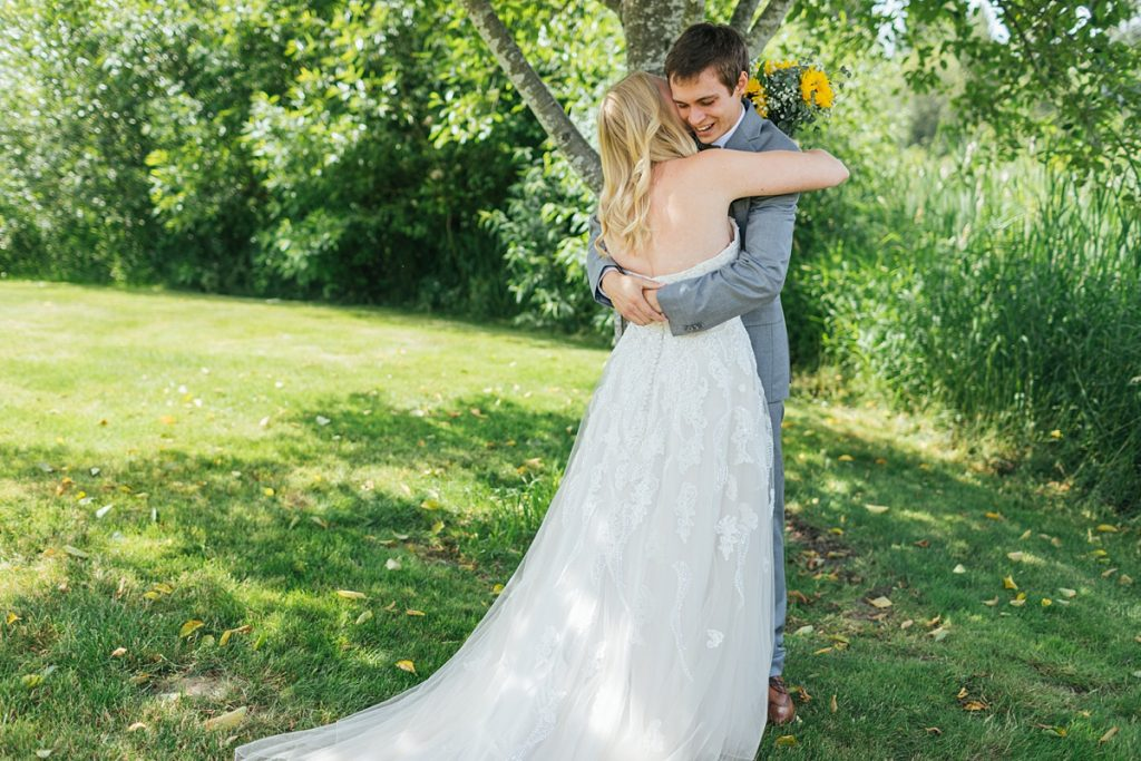 Bostic Lake Ranch Wedding bride and groom hugging after first look