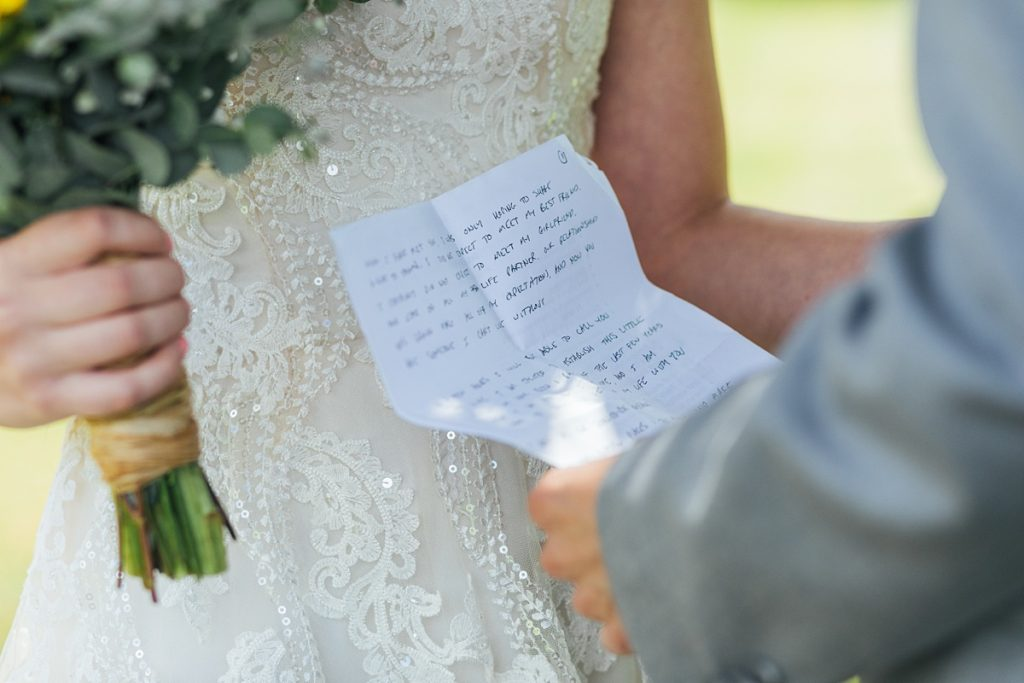 Bostic Lake Ranch Wedding bride and groom exchanging personal vows in private during first look