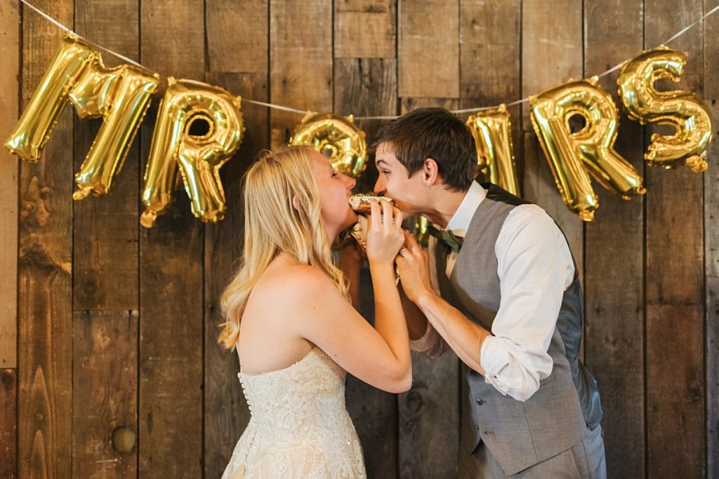 Bostic Lake Ranch Wedding bride and groom biting into a donut