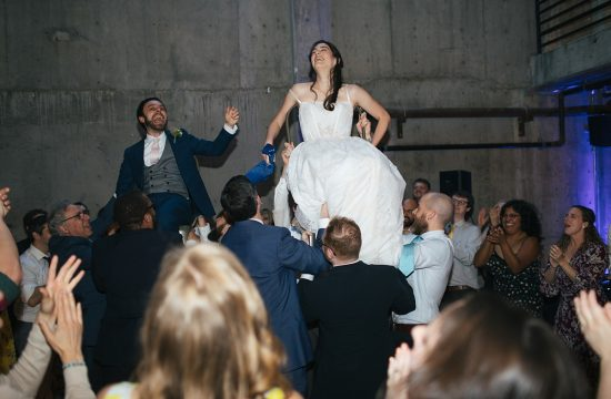 Fremont Foundry Wedding bride and groom being lifted up in chair for traditional jewish dance