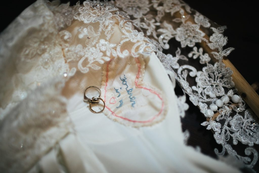 TreeHouse Point Wedding details of rings with dress