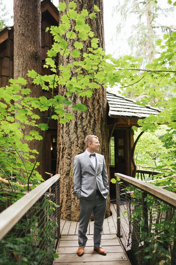 TreeHouse Point Wedding groom standing infront of treehouse