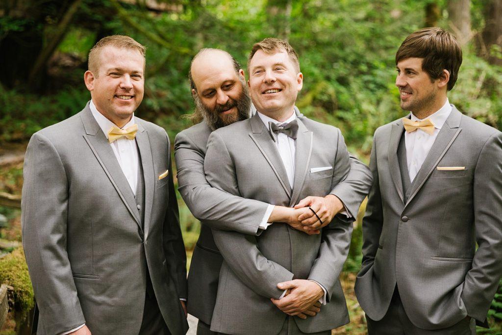 TreeHouse Point Wedding groom being hugged by groomsmen