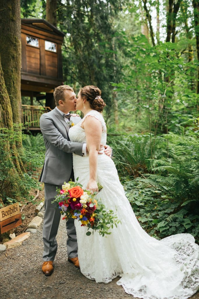 TreeHouse Point Wedding bride and groom portrait with tree house in background