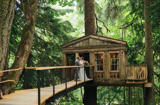 TreeHouse Point Wedding bride and groom portraits with treehouse in background