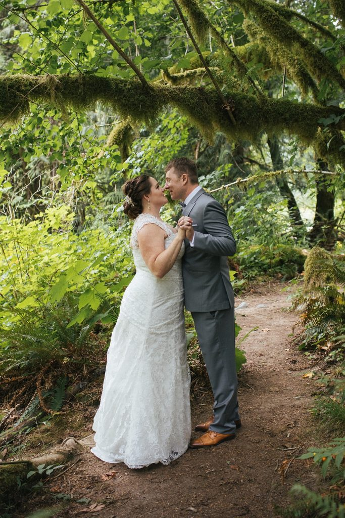 TreeHouse Point Wedding bride and groom portrait in mossy forest