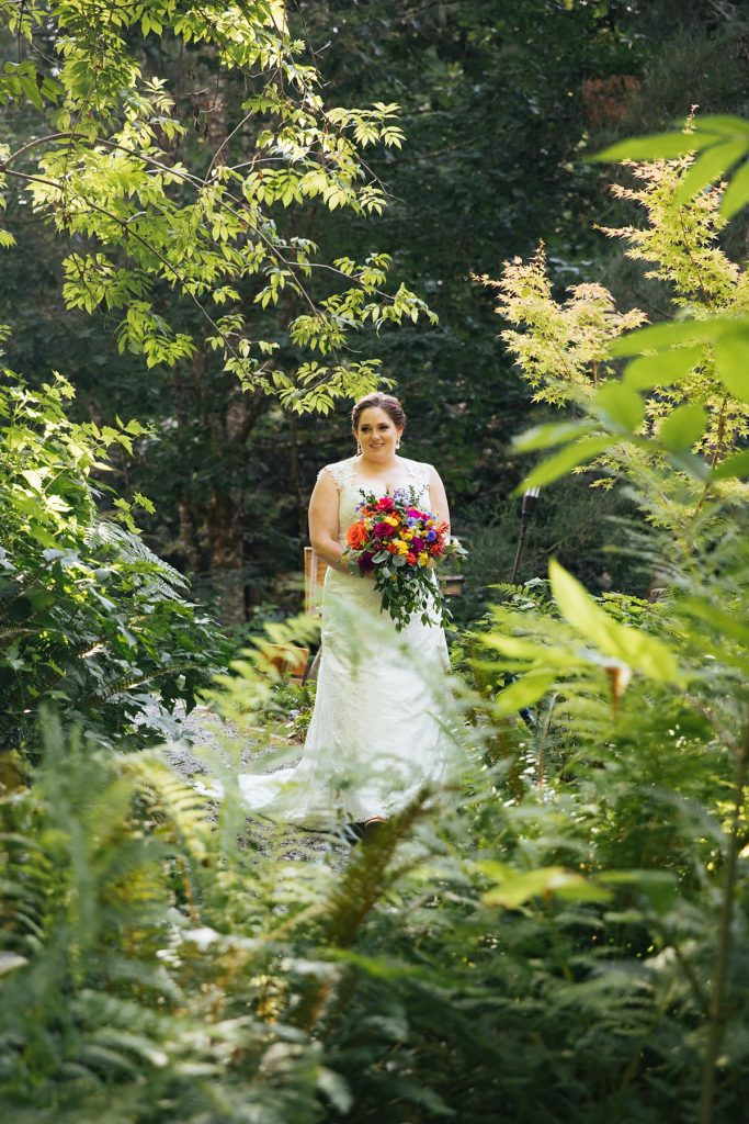 TreeHouse Point Wedding bride walking herself down the aisle