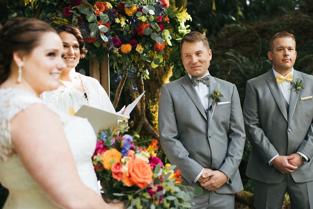 TreeHouse Point Wedding groom looking lovingly at bride during ceremony