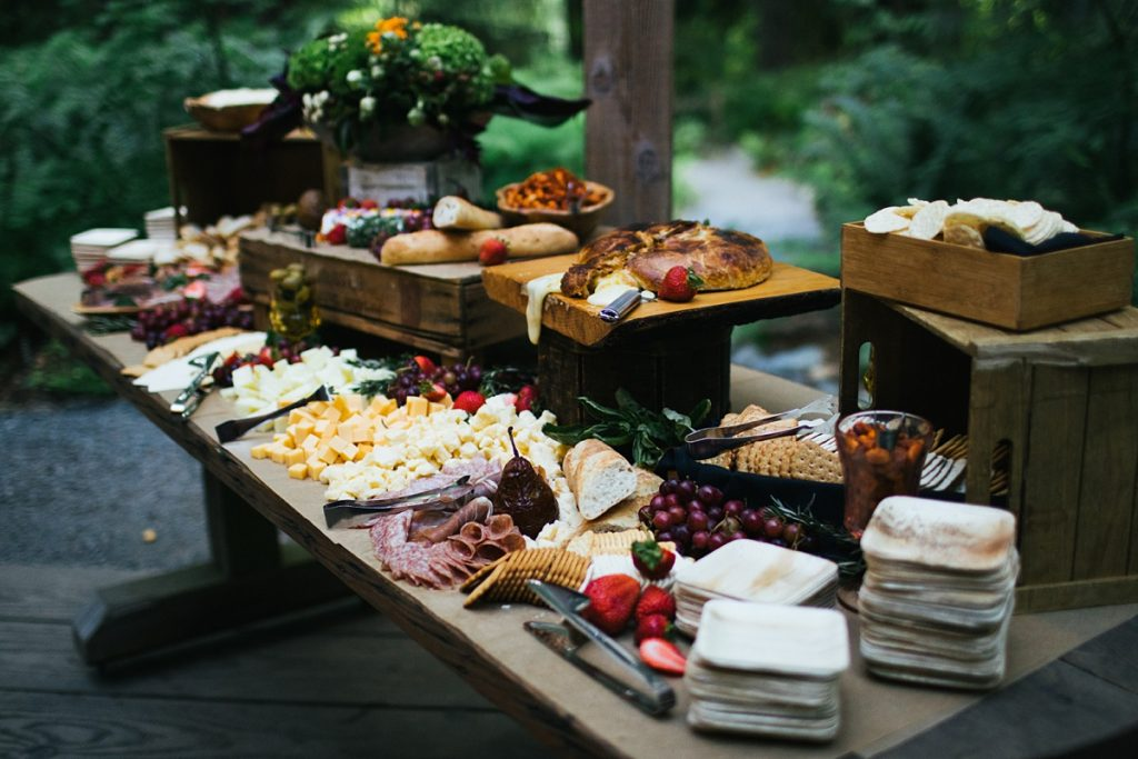 TreeHouse Point Wedding grazing table spread by green apple events and catering