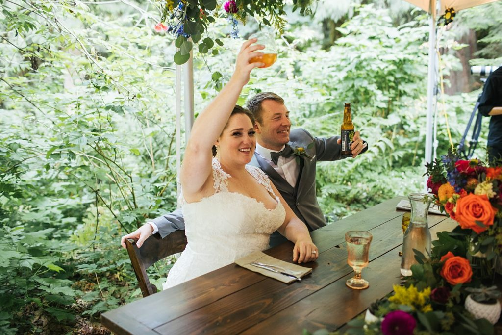 TreeHouse Point Wedding bride and groom toasting to their guests