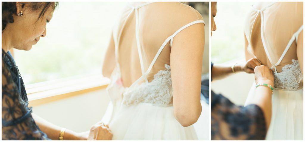 Cedarbrook Lodge Wedding Bride getting dress zipped up