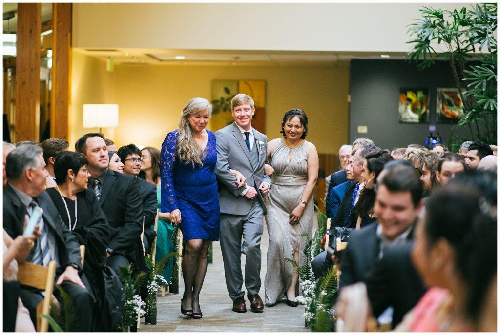 Cedarbrook Lodge Wedding groom walking down aisle with grooms mom and brides mom