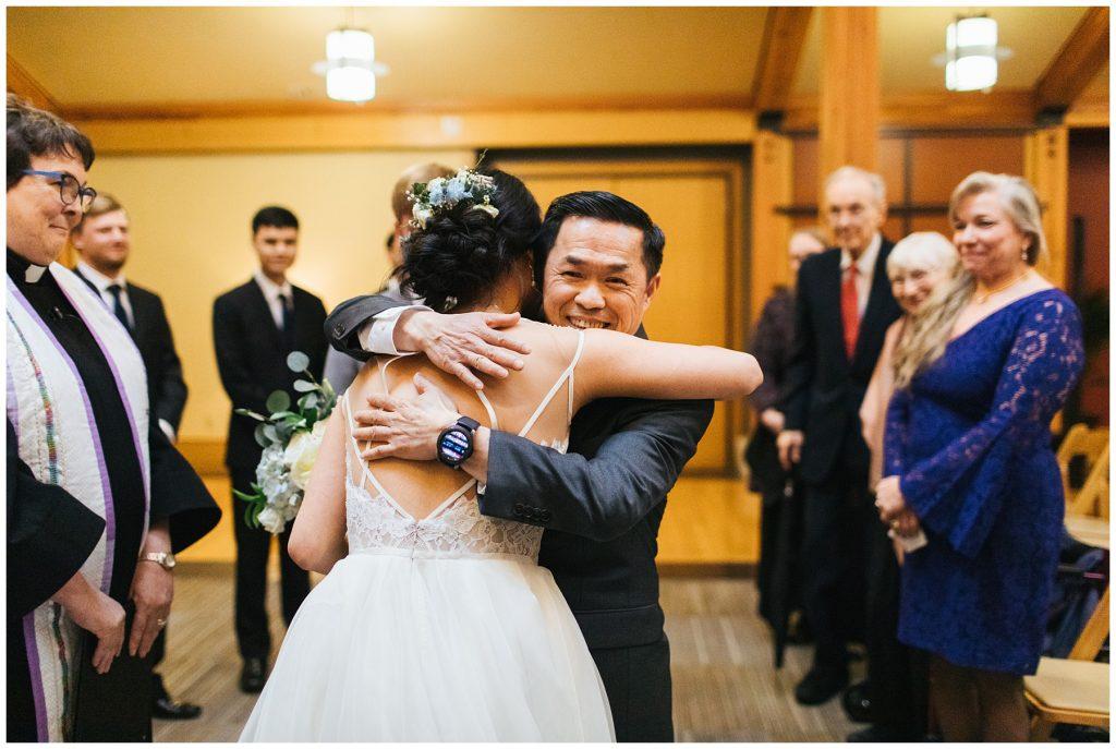 Cedarbrook Lodge Wedding bride hugging dad