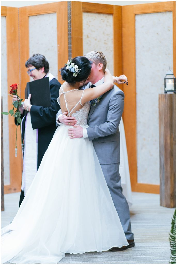 Cedarbrook Lodge Wedding bride and groom first kiss