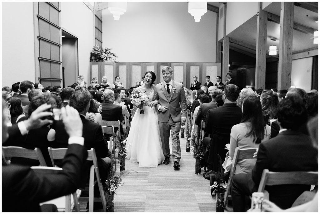 Cedarbrook Lodge Wedding bride and groom processing back down aisle