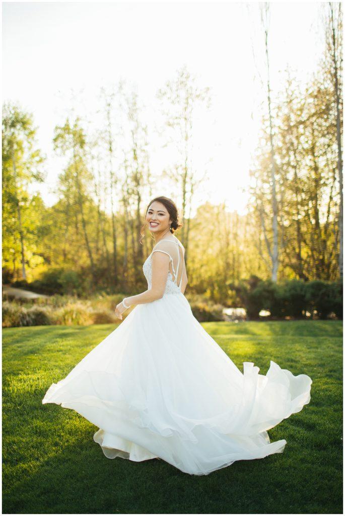Cedarbrook Lodge Wedding bride at golden hour spinning in lavish dress