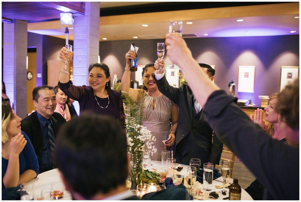 Cedarbrook Lodge Wedding everyone cheers for toast