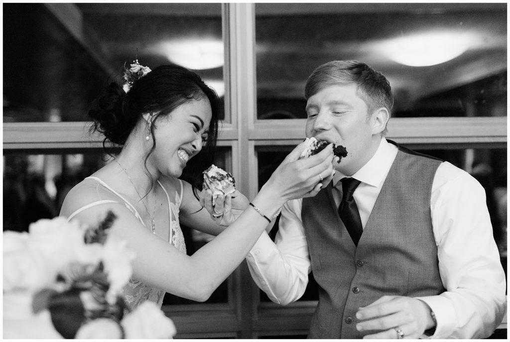 Cedarbrook Lodge Wedding bride and groom feed each other cake