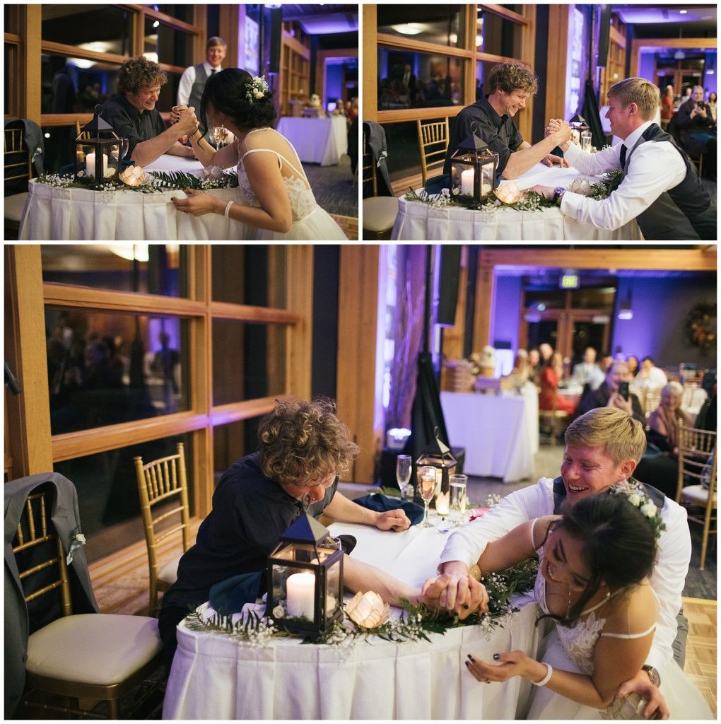 Cedarbrook Lodge Wedding bride and groom play games, bride and groom are arm wrestling the brother of the groom