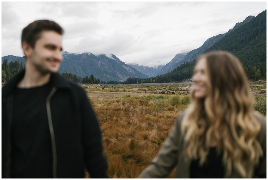 Snoqualmie Pass Lake Keechelus Engagement Session couple in foreground and mountains showing in background