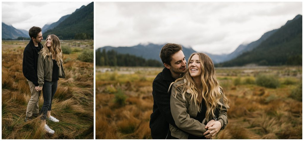 Snoqualmie Pass Lake Keechelus Engagement Session standing in long grass cuddling