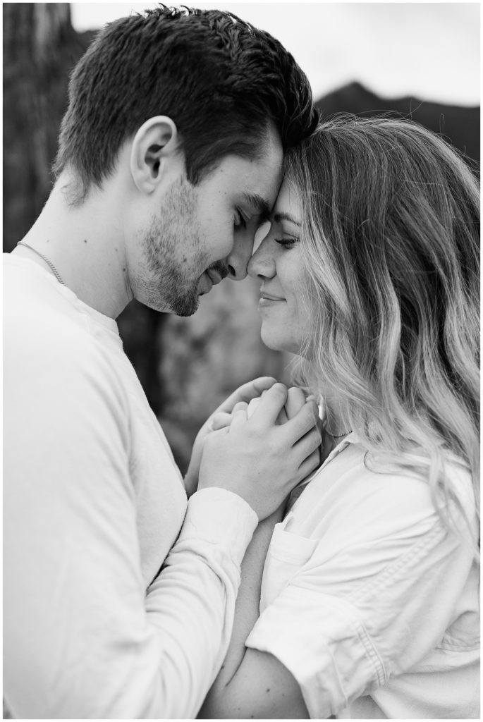 Snoqualmie Pass Lake Keechelus Engagement Session black and white photo with foreheads touching