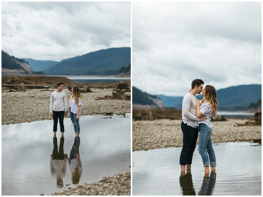 Snoqualmie Pass Lake Keechelus Engagement Session couple standing in large puddle of water