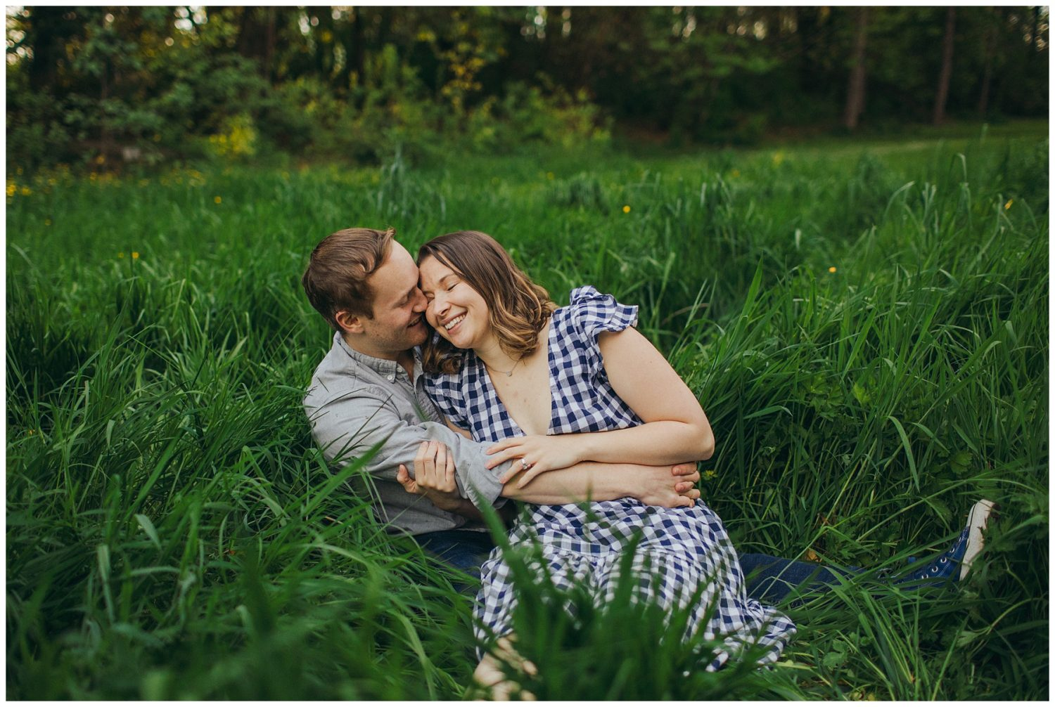 Seward engagement session couple sitting in tall grass