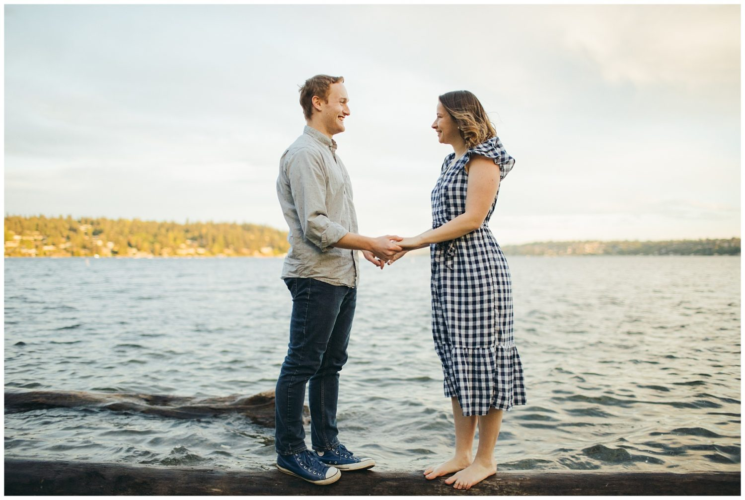 Seward engagement session couple standing on log near water